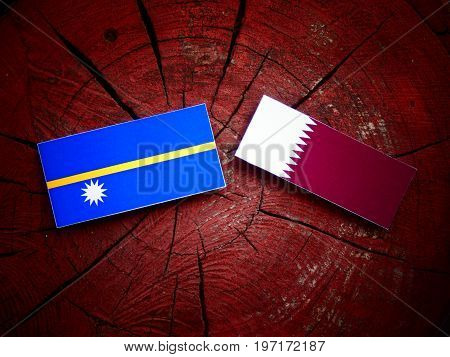 Nauru Flag With Qatari Flag On A Tree Stump Isolated