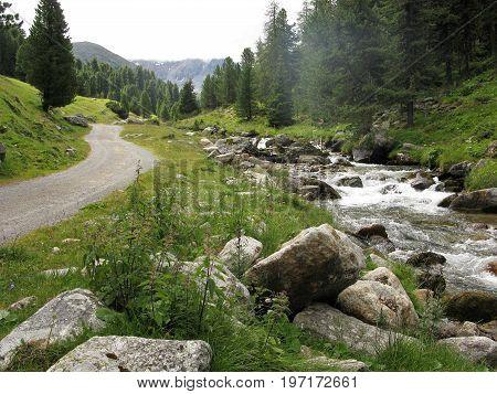 Footpath beside a stream near Scuol, Lower Engadine, Switzerland