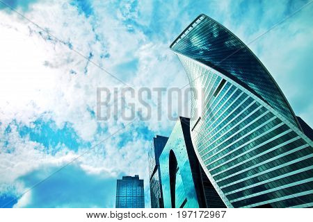 MOSCOW RUSSIA - JULY 17: Moscow international business center Moscow City. Urban metropolis landscape with skyscrapers on July 17 2017 Moscow Russia. Low angle view sky and copy space.