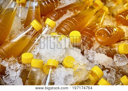Sugarcane juice in plastic bottles chilled in ice