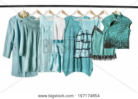 Set of cyan woman clothes on clothes racks on white background