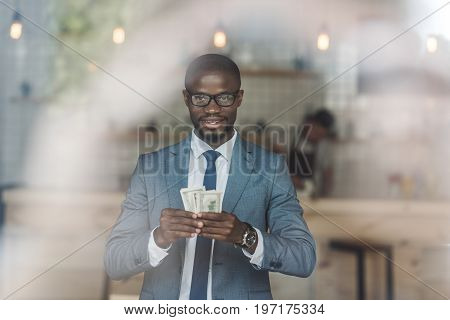 Handsome Happy African American Businessman Holding And Counting Money