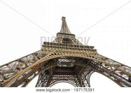 Prospective view of Tour Eiffel, symbol and icon of Paris. Bottom view of Eiffel Tower isolated on white background and copy space. Paris, France, Europe.
