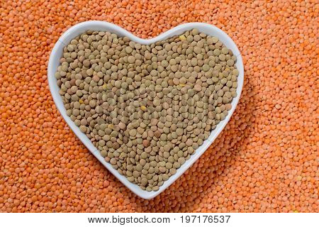 Heart Form Bowl With Green Lentils Over Red Lentils Background