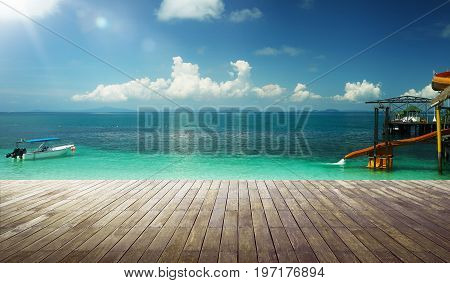 Empty wood jetty floor in front of beautiful afternoon seascape .