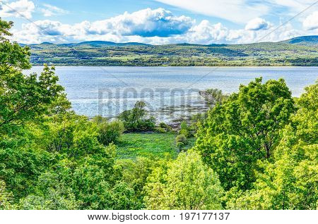 Landscape view of Saint Lawrence river from Ile D'Orleans Quebec Canada in summer with forest