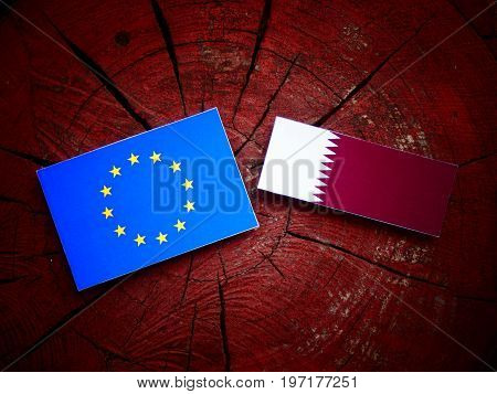 Eu Flag With Qatari Flag On A Tree Stump Isolated