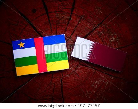 Central African Republic Flag With Qatari Flag On A Tree Stump Isolated