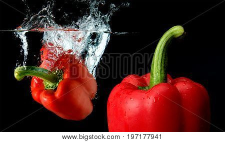 Splash Water From Water Droping Bell Pepper.