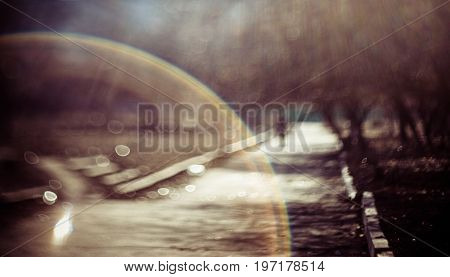 Blurred abstract nature background. Summer defocused view with swirly bokeh and sunbeam