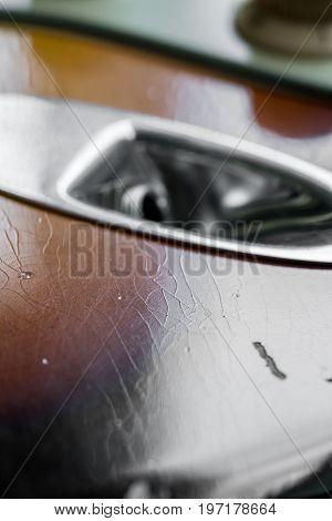 Closeup Of Finish Crack On Sunburst Guitar