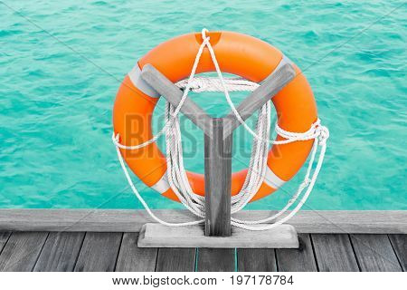 Wooden pontoon with flotation ring at sea resort