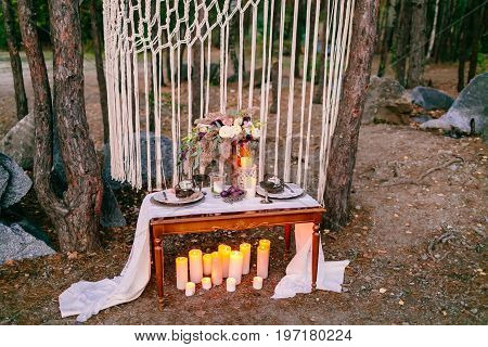 Wedding decorations in rustic style. Outing ceremony. Wedding in nature. Selective focus.