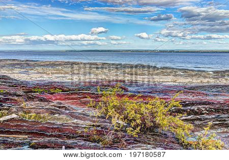 Landscape View Of Saint Lawrence River From Ile D'orleans, Quebec, Canada In Summer With Red Rocks