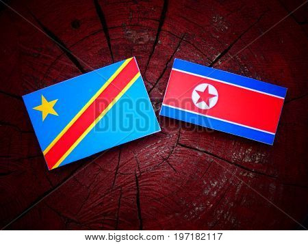 Democratic Republic Of The Congo Flag With North Korean Flag On A Tree Stump Isolated