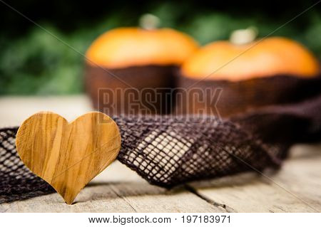 Pumpkins With Jute On Wooden Table