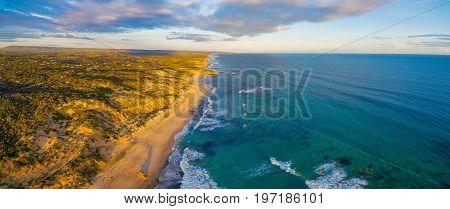 Aerial panoramic view of beautiful ocean coastline at sunset