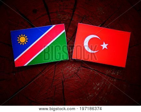 Namibian Flag With Turkish Flag On A Tree Stump Isolated