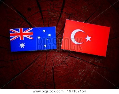 Australian  Flag With Turkish Flag On A Tree Stump Isolated