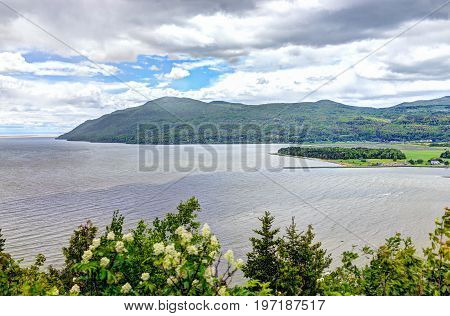 Baie-saint-paul In Quebec, Canada Cityscape Or Skyline With Mountains On Coast And Saint Lawrence Ri