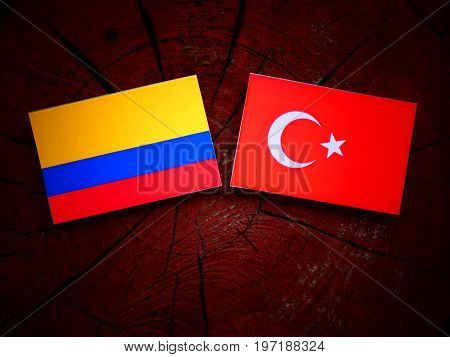 Colombian Flag With Turkish Flag On A Tree Stump Isolated