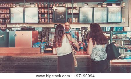 Istanbul, Turkey - June 02, 2017: Barista And Customer At Starbucks Coffee Shop In Istanbul.