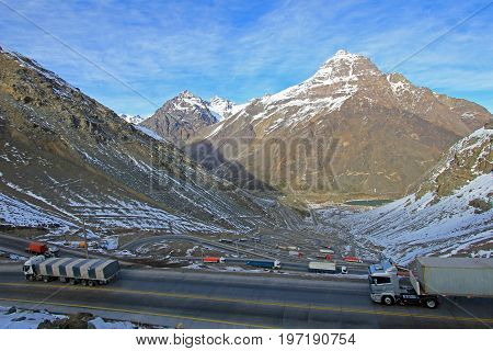 Truck traffic in the hairpin curves at Paso International Los Libertadores or Cristo Redentor, Chile, South America