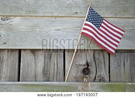 American flag decoration on rustic barn wood siding