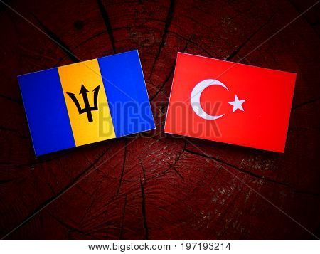 Barbados Flag With Turkish Flag On A Tree Stump Isolated