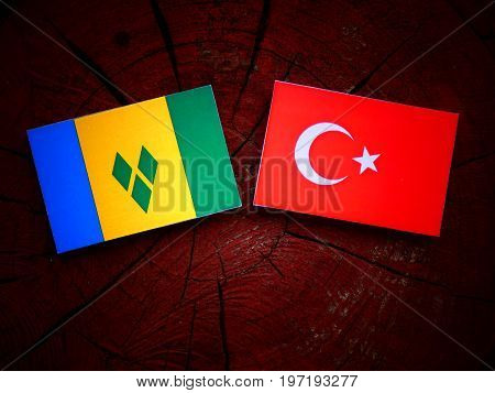 Saint Vincent And The Grenadines Flag With Turkish Flag On A Tree Stump Isolated