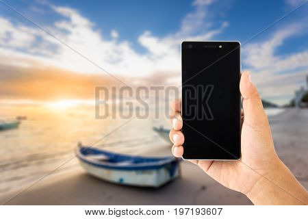 Hand Use Smartphone Withboat By The Beachside During Beautiful Sunrise