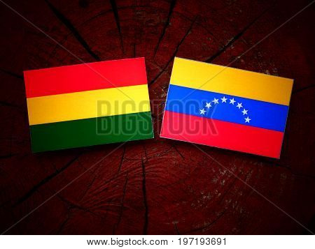 Bolivian Flag With Venezuelan Flag On A Tree Stump Isolated