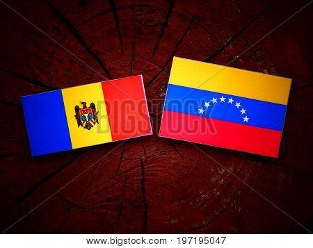 Moldovan Flag With Venezuelan Flag On A Tree Stump Isolated