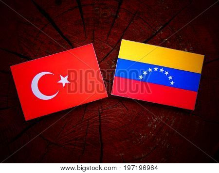 Turkish Flag With Venezuelan Flag On A Tree Stump Isolated