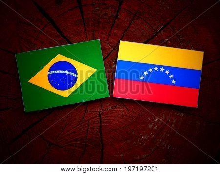 Brazilian Flag With Venezuelan Flag On A Tree Stump Isolated