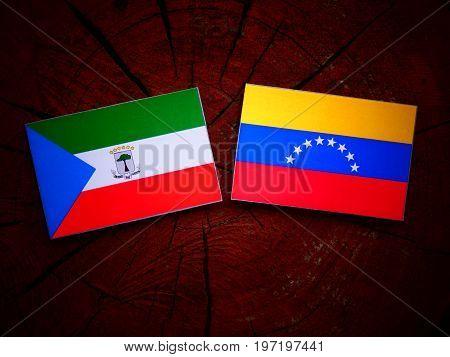 Equatorial Guinea Flag With Venezuelan Flag On A Tree Stump Isolated