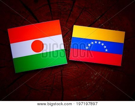 Niger Flag With Venezuelan Flag On A Tree Stump Isolated