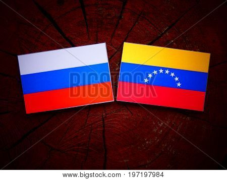 Russian Flag With Venezuelan Flag On A Tree Stump Isolated