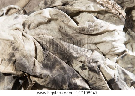 dirty rags in oil as background . A photo