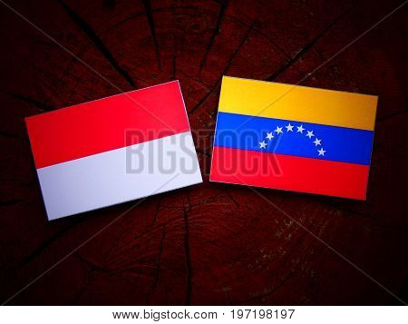 Indonesian Flag With Venezuelan Flag On A Tree Stump Isolated
