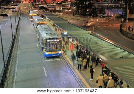 BRISBANE AUSTRALIA - JULY 8, 2017: Unidentified people visit commute by bus in downtown Brisbane.