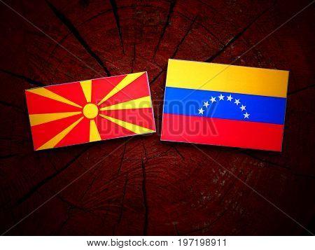 Macedonian Flag With Venezuelan Flag On A Tree Stump Isolated