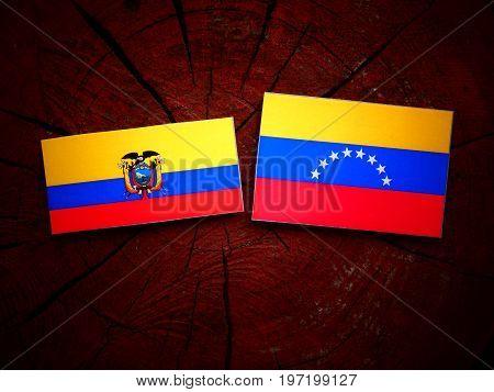Ecuador Flag With Venezuelan Flag On A Tree Stump Isolated