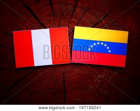 Peruvian Flag With Venezuelan Flag On A Tree Stump Isolated