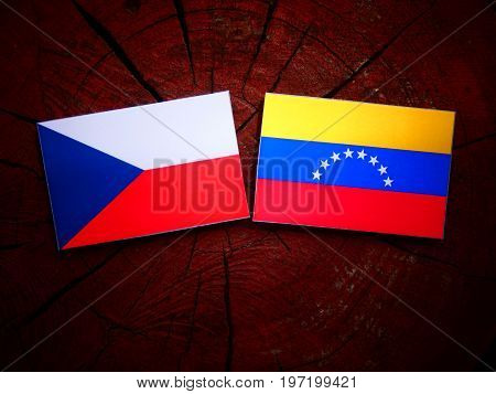 Czech Flag With Venezuelan Flag On A Tree Stump Isolated