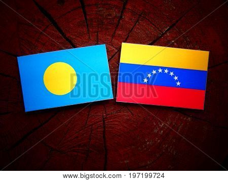 Palau Flag With Venezuelan Flag On A Tree Stump Isolated