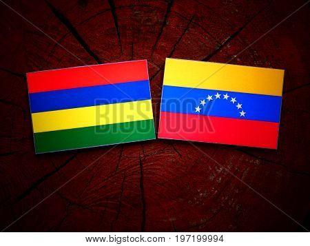 Mauritius Flag With Venezuelan Flag On A Tree Stump Isolated
