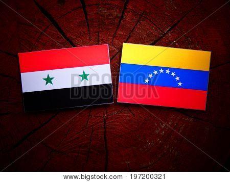 Syrian Flag With Venezuelan Flag On A Tree Stump Isolated