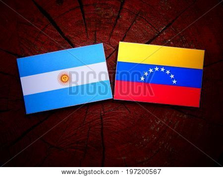 Argentinian Flag With Venezuelan Flag On A Tree Stump Isolated