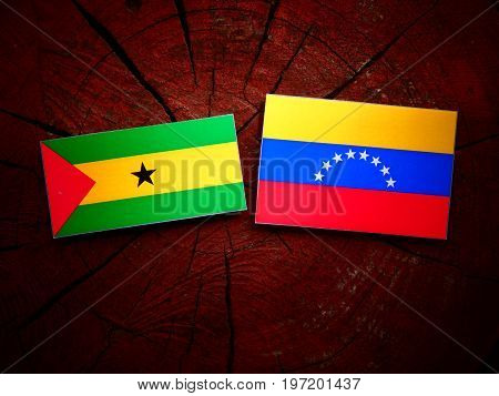 Sao Tome And Principe Flag With Venezuelan Flag On A Tree Stump Isolated